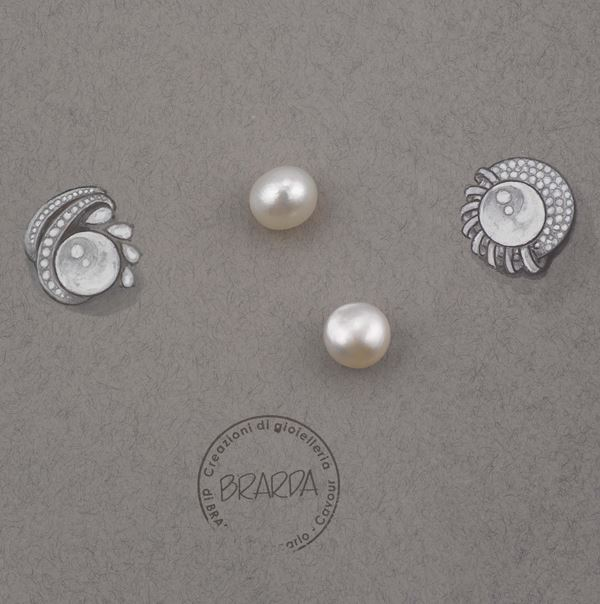 A pair of natural unmounted pearls. CISGEM reports