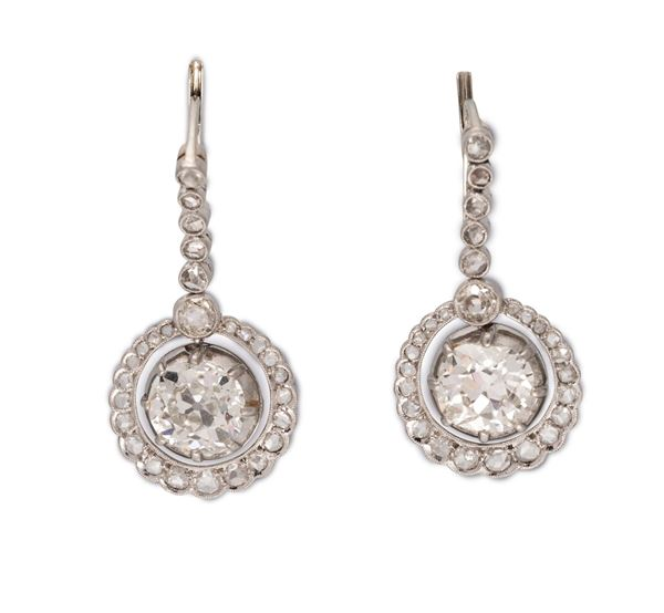 A pair of old-cut diamond earrings. Fitted with a dual mount