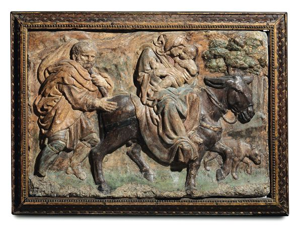 A polychrome stucco depicting the Flight into Egypt within a frame in carved and gilt wood. Italian Renaissance modeler (from Jacopo della Quercia), Bologna, second half of the 15th century