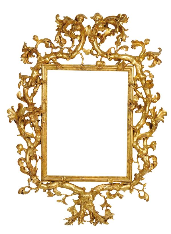 An important frame in sculpted, carved and gilded wood, Rome, third quarter of the 17th century.