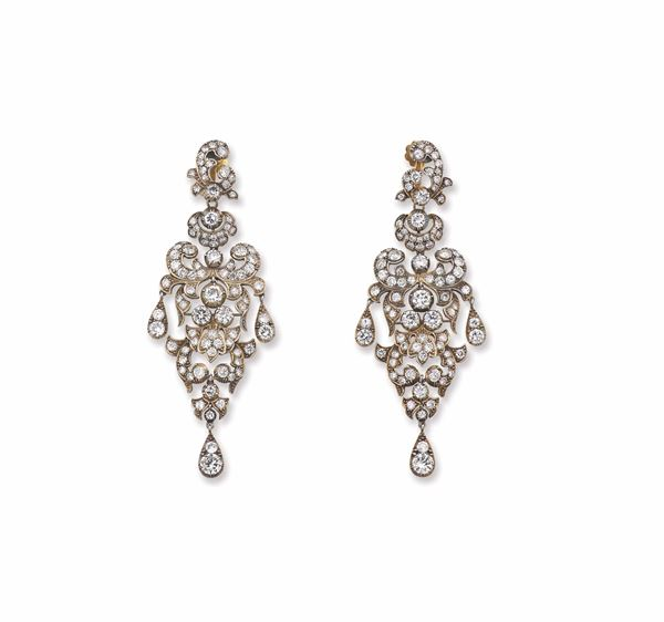 A pair of diamond, gold and silver chandelier earrings. Fitted case