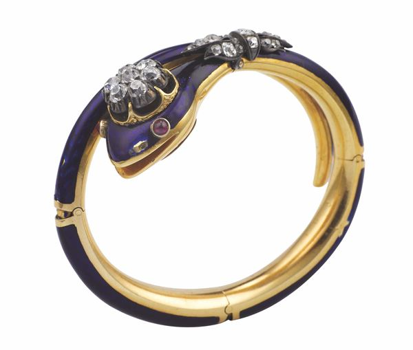 An enamel and diamond bangle. Fitted case