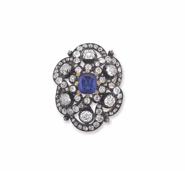 A sapphire, diamond and silver brooch