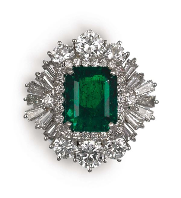 An emerald and diamond ring. Gubelin report