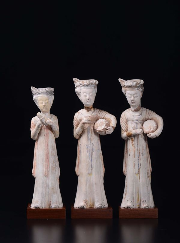 Three painted pottery figures of musicians, China, Tang Dynasty (618-906)