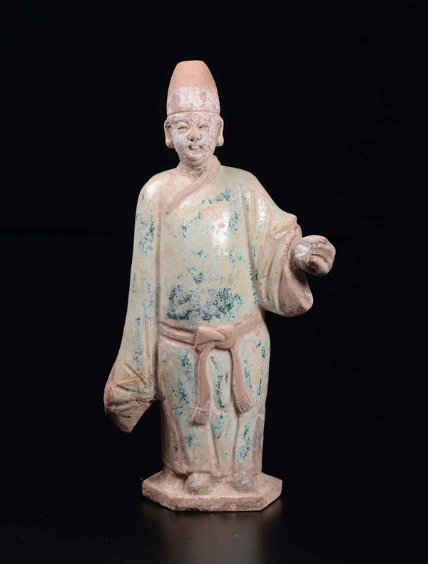 A glazed pottery figure of dignitary, China, Ming Dynasty, 17th century