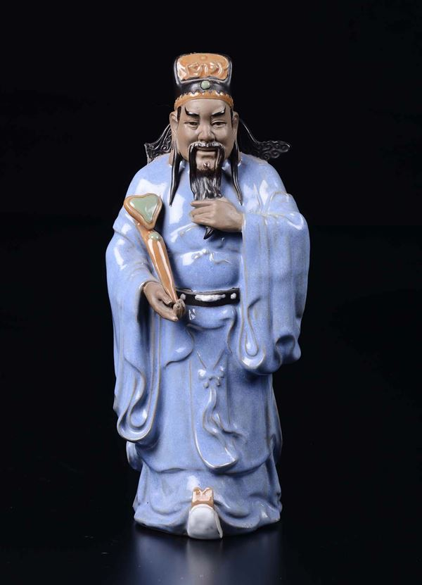 A glazed pottery figure of dignitary with ruyi, China, early 20th century