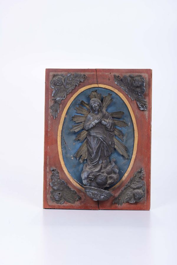 A silver Holy water stoup with the Madonna on lacquered panel