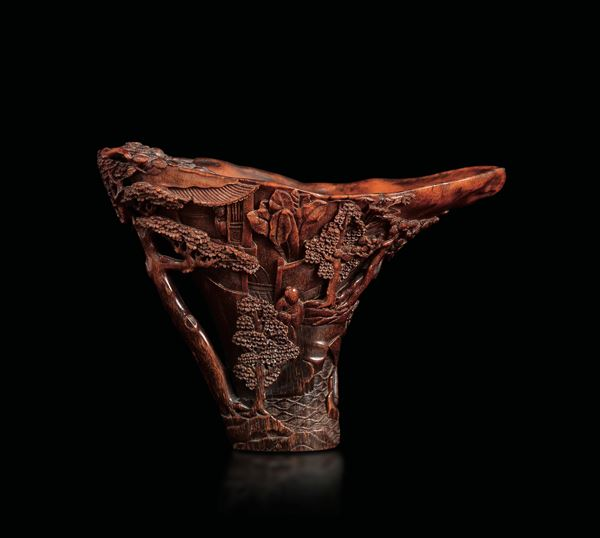 An extraordinary finely carved rhino horn libation cup with wise men within landscape, China, Qing Dynasty,  [..]