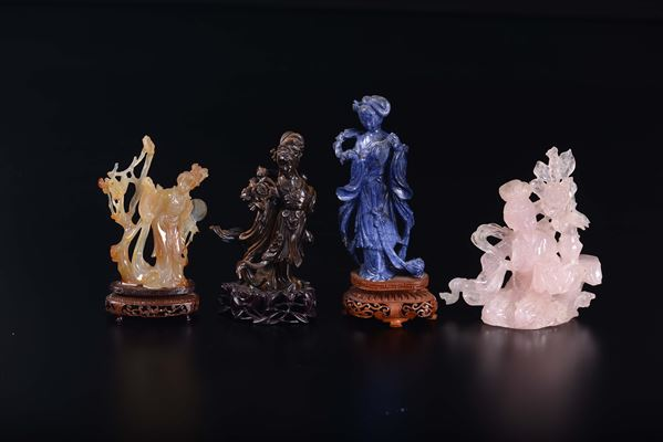 Three carved figures of Guanyin: a lapis lazuli one, a tiger's-eye one, a rose quartz and an agate one, China, 20th century