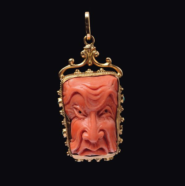 A carved coral pendant with gold setting and turquoise inlays, China, early 20th century