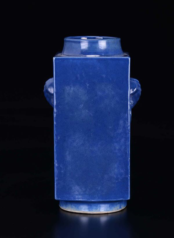 A blue-ground porcelain Cong vase with elephant-head handles, China, Qing Dynasty, Guangxu Mark and  [..]