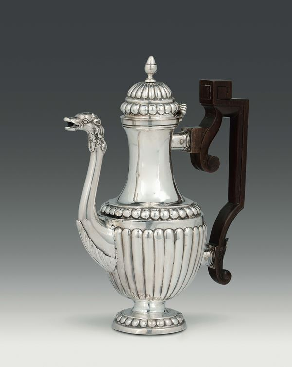 A coffee pot in embossed, molten, chiselled silver and handle in shaped wood, Genova, Torretta punch  [..]