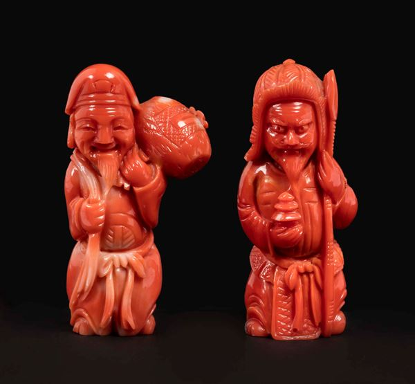 Two small carved coral figures, a wise man with saddlebag and a warrior with spear, China, early 20th century