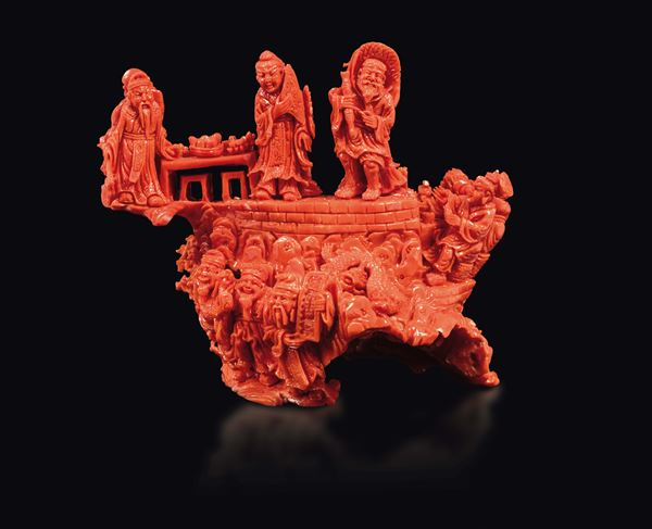 A carved coral group with common life scenes and dragons, China, early 20th century