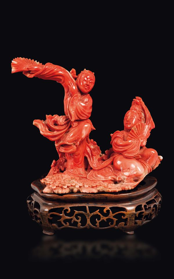 A carved coral two Guanyin with fan group, China, early 20th century