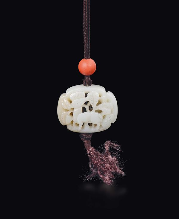 A fretworked white jade with deer, China, Qing Dynasty, 19th century
