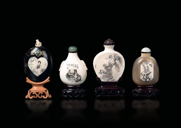 Four carved ivory and horn snuff bottles with figures and inscriptions, China, early 20th century