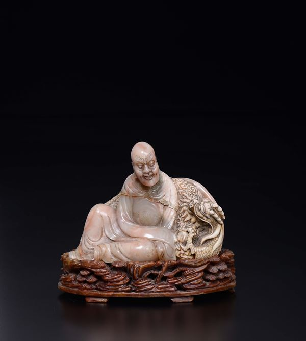 A soapstone figure of wise man and stand, China, Qing Dynasty, late 19th century