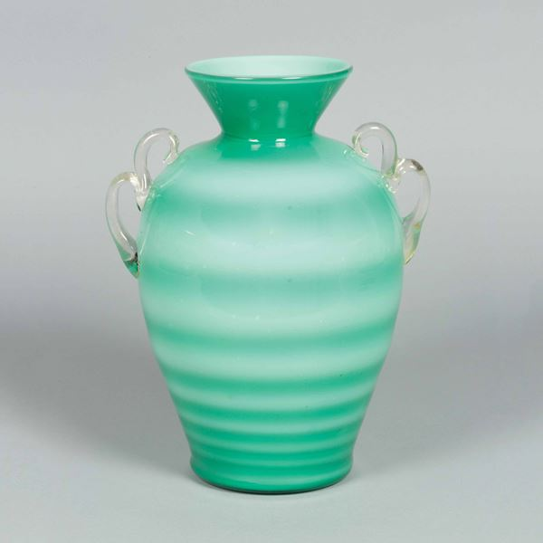 Flavio Poli, 1937 ca. An ovoidal glass vase with a flared neck, applied handles and a stamped band decor. Vaso incamiciato a stampo orizzontale