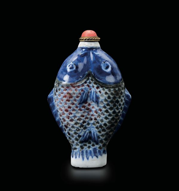 A porcelain double carp snuff bottle, China, Qing Dynasty, 19th century