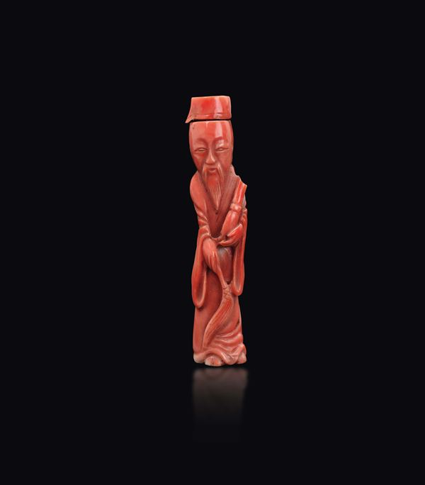 A carved coral wise man snuff bottle, China, early 20th century