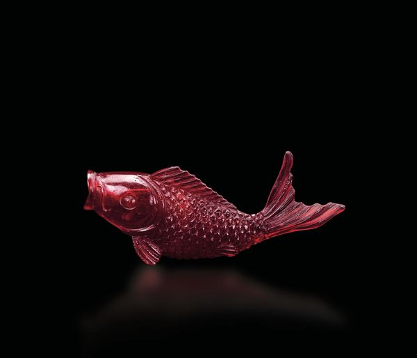 A red glass fish snuff bottle, China, Qing Dynasty, 19th century