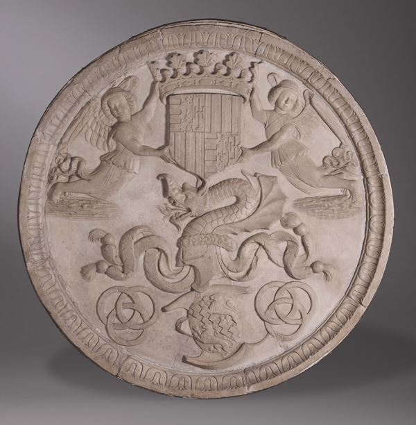 A monumental round bas-relief in marble with heraldic scenes, sculptor active in the Aragonese court in the last quarter of the 15th century