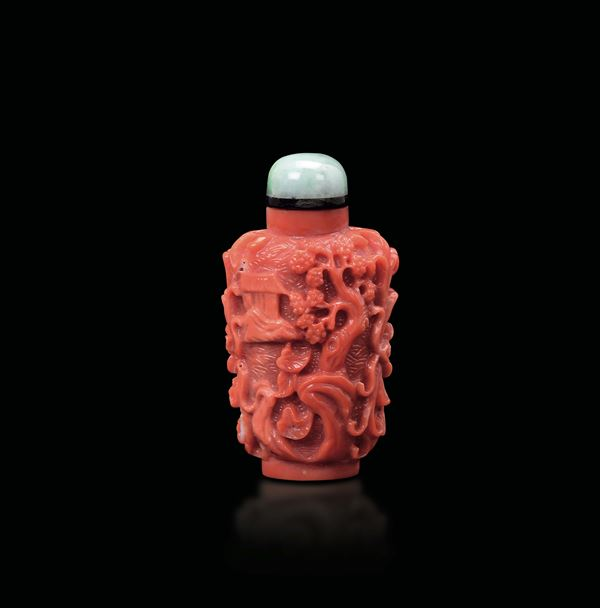 A small carved coral snuff bottle with jadeite stopper, China, early 20th century