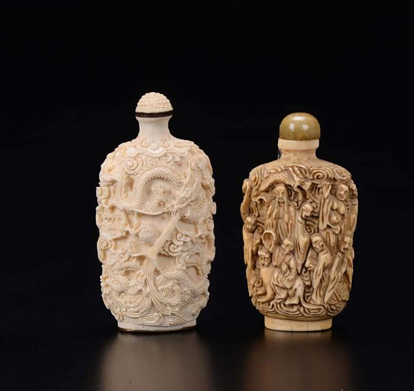 Two carved ivory snuff bottles with decoration in relief, China, early 20th century