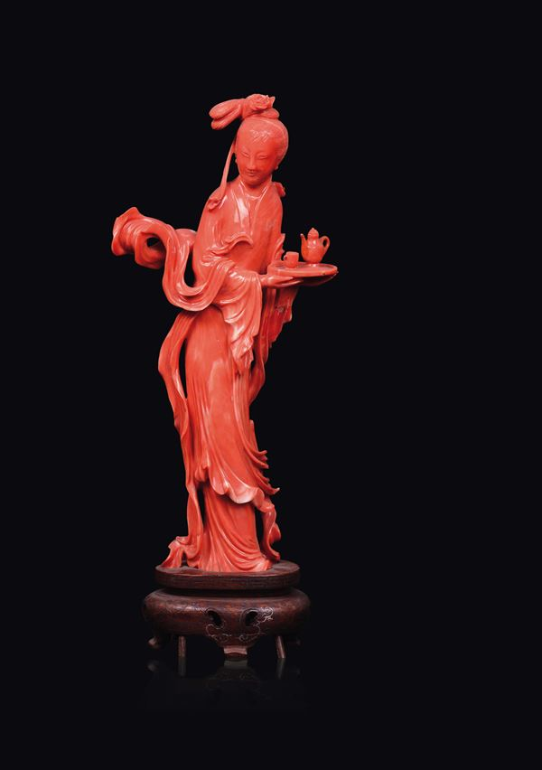A carved coral figure of Guanyin with tray, China, early 20th century