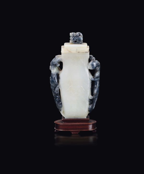 A yellow and russet jade vase and cover, China, Qing Dynasty, 19th century