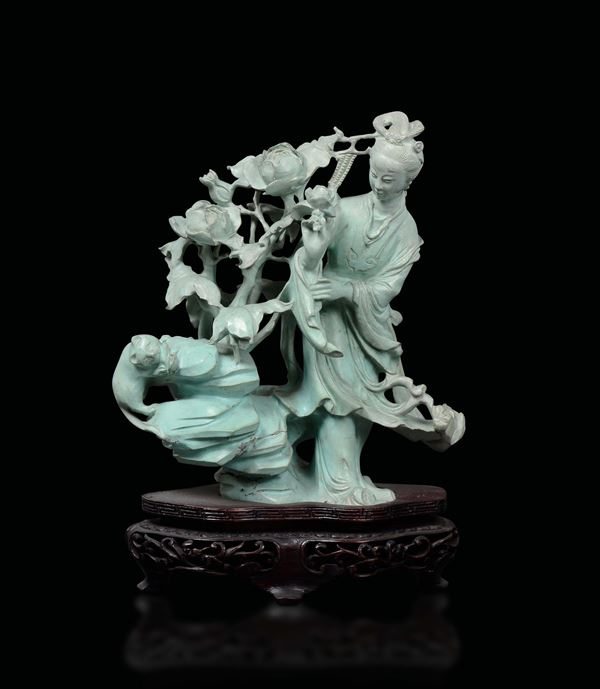 A turquoise Guanyin with roses and cat on a rock group, China, early 20th century