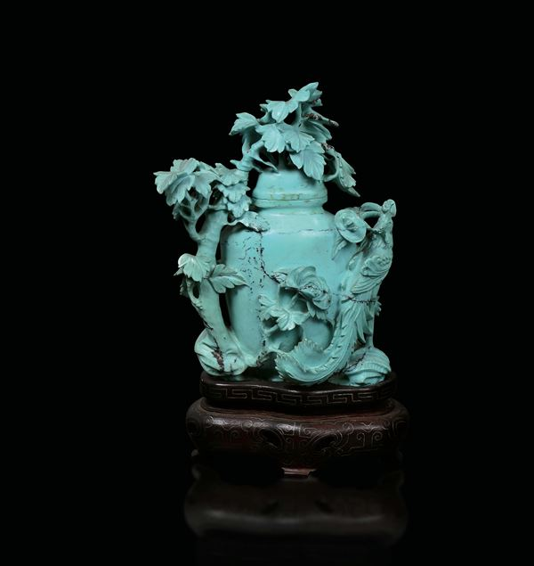 A small turquoise vase and cover with branches and peacock in relief, China, early 20th century