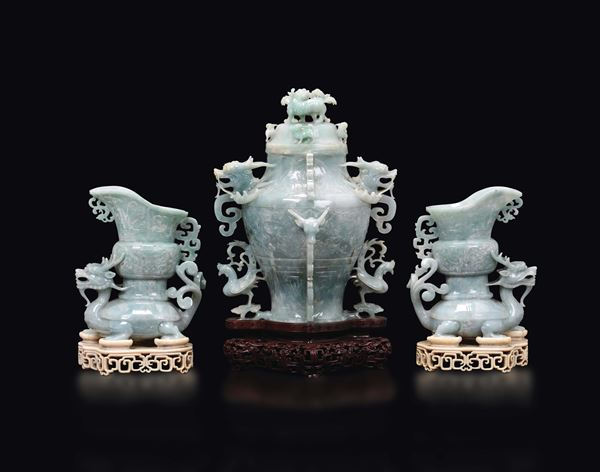 A jadeite triptyque: a vase with dragons and two mythical beast with vase on their back with ivory stands, China, early 20th century