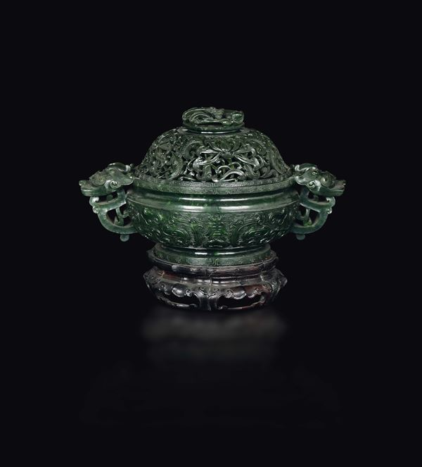A fretworked spinach green jade cup and cover with an archaic style motif, China, Qing Dynasty, Qianlong Period (1736-1795)