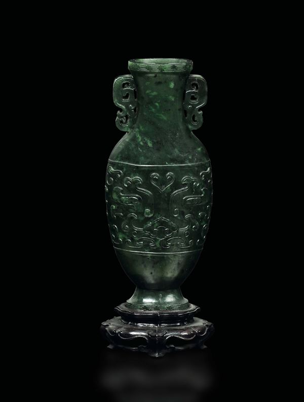 A small spinach green jade vase with an archaic style motif in relief, China, Qing Dynasty, Qianlong Period (1736-1795)