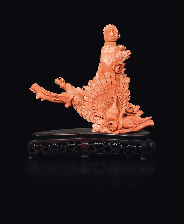 A carved coral peacocks and vase group, China, early 20th century