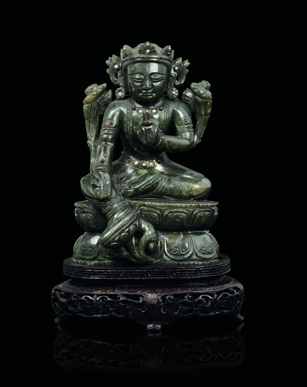 A spinach green jade figure of Buddha on a lotus flower with semi-precious stones inlays, China, Qing Dynasty, Qianlong Period (1736-1795)
