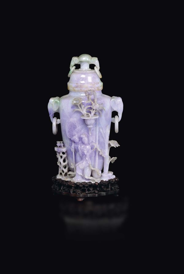 A large lavender and apple green shades jadeite vase and cover with elephant-heads handles and Guanyin with child in relief, China, early 20th century