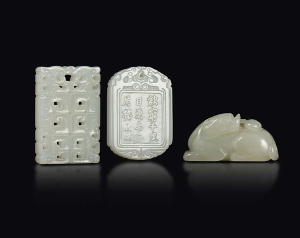 Three carved white jades: a Pho dog and two plaques, one with inscriptions and landscape and one with archaic style motif, China, 20th century