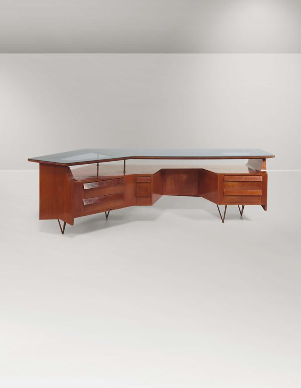 A large wooden and glass table with brass details