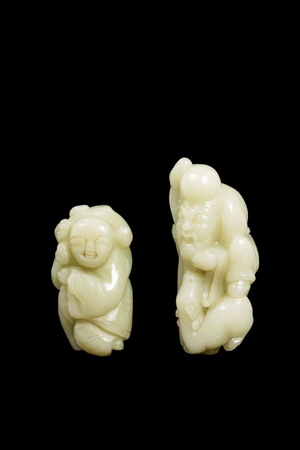 Two white jade figures, a wayfarer and a wise man with stick, China, 20th century