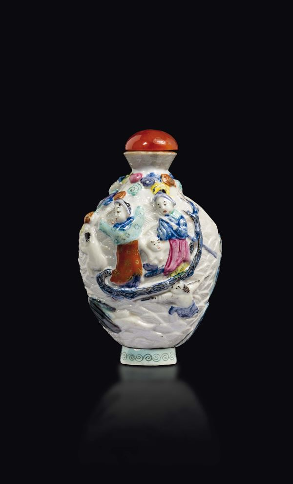 A polychrome enamelled porcelain snuff bottle with figures in relief, China, Qing Dynasty, 19th century