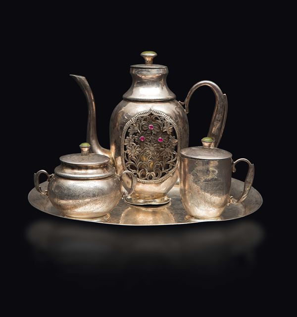 A silver tea set with tray: a fretworked with ruby inlays teapot, a sugar bowl and a milk jug, China, Qing Dynasty, 19th century