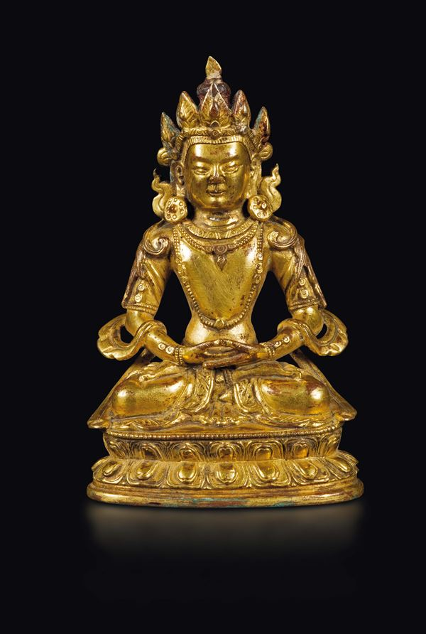 A gilt bronze figure of Amitayus on a double lotus flower, China, Qing Dynasty, 18th century