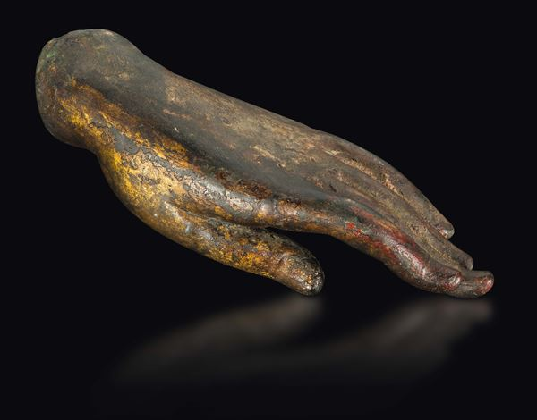 A bronze Buddha's hand with traces of gilt, China, Ming Dynasty, 15th century
