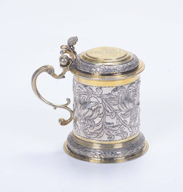 A tankard in embossed, gilded and chiselled silver, Germany (Ausburg?) 17th-18th century