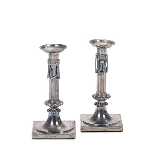 A pair of candlesticks in molten, embossed and chiselled silver, Ausburg 1809, silversmith MO