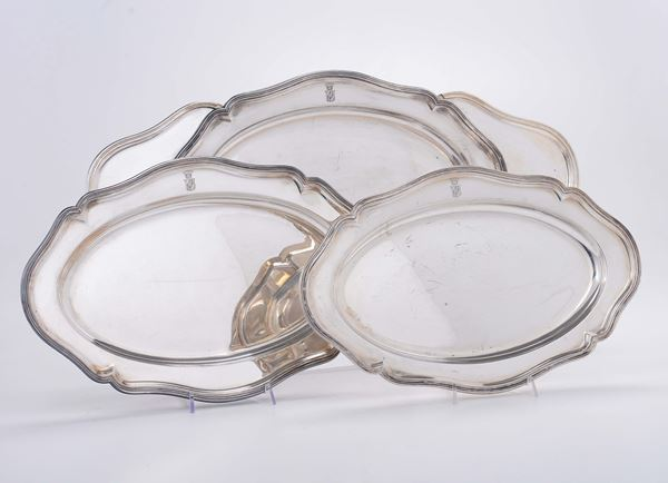 Three platters in embossed and chiselled silver, one of which with an extension, Germany end of the 19th century